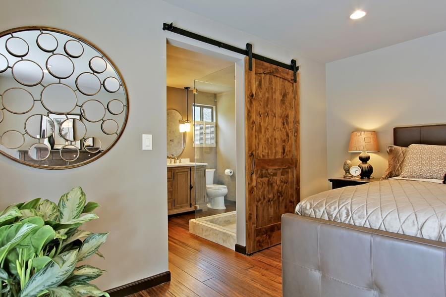 bedroom home interior design with sliding wood barn door and large round decorative mirror barn doors for interior design.html