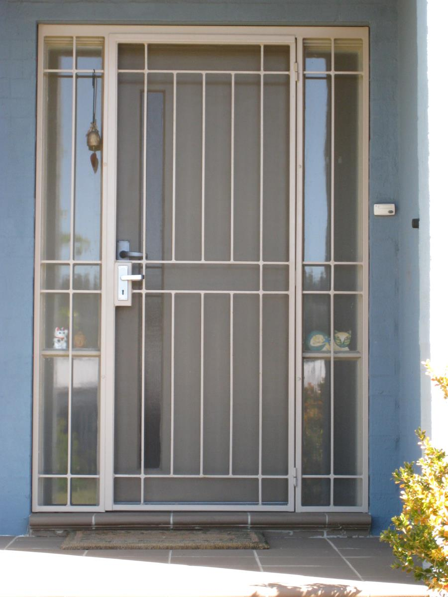 interior awesome security screen doors with white iron style and blue wall with garden beauteous security screen doors with unique carving metal safety door designs for flats.html