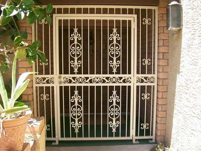 single door steel gate design the moon security door sd wrought iron beautiful gate adds to & 97+ Stainless Steel Main/Front Door Design with Grill for Home